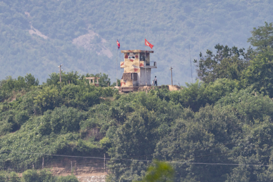 A North Korean soldier is spotted near a guard post on the northern side of the Imjin River, viewed from the border area in Paju, Gyeonggi, as Seoul and Washington kicked off their nine-day summertime military exercise Monday. Pyongyang has remained mum on the joint exercise as of Monday afternoon. [YONHAP]