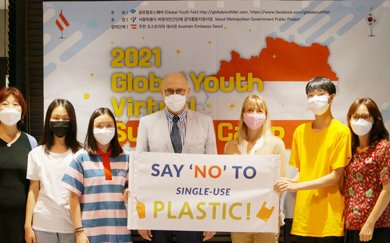Ambassador of Austria to Korea Wolfgang Angerholzer, fourth from right; Irene Nuutila, a public speaker on plastics and environments, third from right; Lee Bock-hee, founder of the Global Youth Fair, far left; and some participants of the 2021 Global Youth Virtual Summer Camp, an annual conference for students in Korea to hear from international speakers on a number of issues such as climate change, pose together following the conference on Saturday. [GLOBAL YOUTH FAIR]