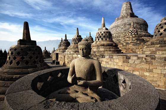 One of 72 stupas, each holding a statue of Buddha, on the Borobudur Temple Compounds in central Java, Indonesia. The temple compounds, dating back to the 8th and 9th centuries, were inscribed as a Unesco World Heritage site in 1991. [BOROBUDUR PARK MANAGEMENT]
