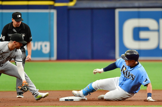 Choi Ji-man of the Tampa Bay Rays slides into second after hitting a double at Tropicana Field in St Petersburg, Florida on Sunday. [AFP/YONHAP]