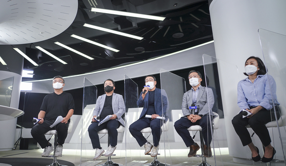 Managers at SK Telecom sit down for a press conference on Wednesday introducing the company's new subscription business ″T Universe.″ [SK TELECOM]
