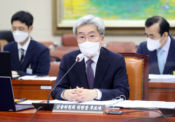 Koh Seung-beom, nominated as the chairman of the Financial Services Commission, answers questions during a confirmation hearing held Friday at the National Assembly in Yeouido, western Seoul. [YONHAP]