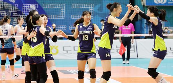 Suwon Hyundai E&C Hillstate players celebrate after beating the GS Caltex Seoul KIXX in the final of the 2021 KOVO Cup at Uijeongbu Gymnasium in Uijeongbu, Gyeonggi on Sunday. [NEWS1]