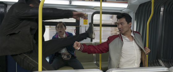 """Shang-Chi (Simu Liu), right, and his friend Katy (Awkwafina) as they come across his father's men in San Francisco in the film """"Shang-Chi and the Legend of the Ten Rings."""" [WALT DISNEY COMPANY KOREA]"""