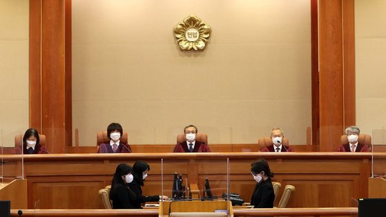 Constitutional justices sit to announce their ruling on a constitutional petition filed by a Korean conscripted by Japan during the colonial period and convicted as a war criminal. [NEWS1]