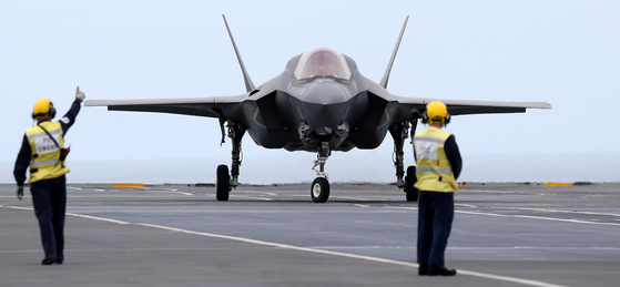 An F-35B stealth fighter jet prepares for takeoff as the British aircraft carrier HMS Queen Elizabeth and its fleet sailed in the East Sea Tuesday for a joint marine drill with Korea for humanitarian and disaster relief missions. [JOINT PRESS CORPS]