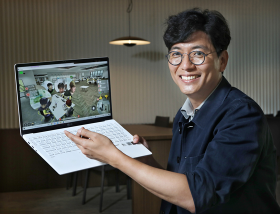 Ahn Sung-woo, founder and CEO of Zigbang, poses for a photo while logged into the company's Metapolis metaverse, which supports remote working. [PARK SANG-MOON]