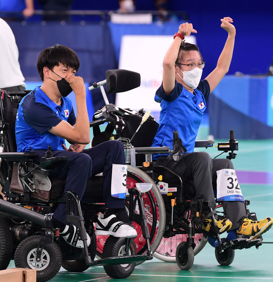 Jeong Ho-won, left and Choi Ye-jin react after winning the mixed pairs boccia sport class three gold medal match at the 2020 Tokyo Paralympics on Saturday at the Ariake Arena in Tokyo. [JOINT PRESS CORPS]