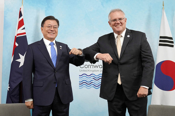President Moon Jae-in, left, with Australia's Prime Minister Scott Morrison, meet on the sideline of the G7 summit in Cornwall, England, in June. [BLUE HOUSE]