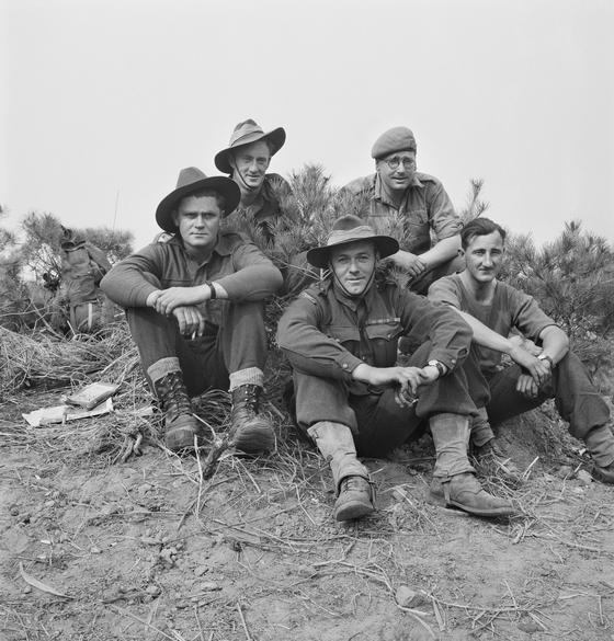 Members of 4 Platoon, B Company, 3RAR rest near Kapyong the day after the battle in the Korean War, on April 26, 1951. [AUSTRALIAN WAR MEMORIAL]