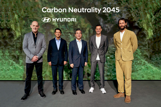 From left, Michael Cole, president and CEO of Hyundai Motor Europe, Jose Munoz, global chief operating officer at Hyundai Motor, Chang Jae-hoon, president and CEO of Hyundai Motor, Thomas Schemera, global chief marketing officer of Hyundai Motor, and environmentalist David De Rothschild, a promotional ambassador for Hyundai Motor's Ioniq brand, at a press event Monday in Munich, Germany, ahead of the 2021 International Motor Show.