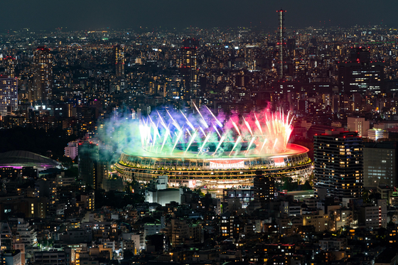 Fireworks explode over the Olympic Stadium during the closing ceremony of the 2020 Tokyo Paralympic Games in Tokyo on Sunday. [XINHUA/YONHAP]