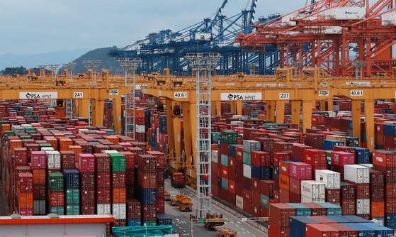 Containers are stacked at the Busan New Port early this month. [YONHAP]