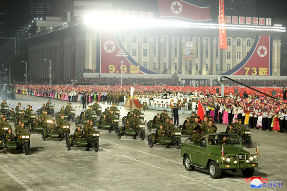 Public security personnel participate in an overnight parade in Kim Il Sung Square in Pyongyang on Thursday during the regime's celebration of the 73rd anniversary of its founding. [YONHAP]