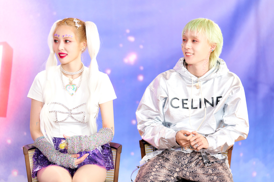 HyunA and Dawn discuss their new EP at the press conference. [P NATION]
