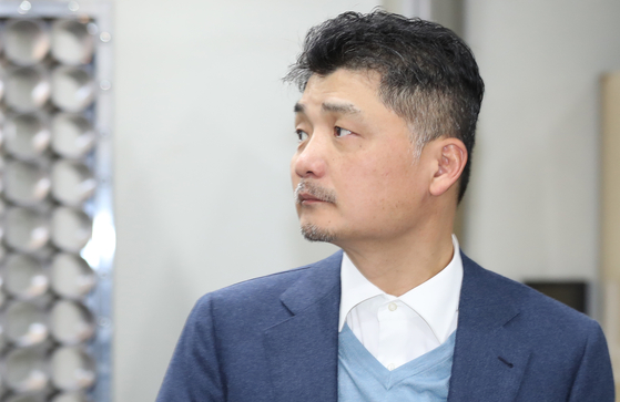 Kakao founder and chairman Kim Beom-su in Seoul in March 2019. Kim is again reportedly accused of omitting information of a de facto holdings company which he entirely owns and control Kakao from. [YONHAP]
