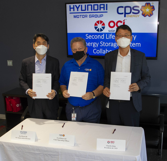 From left, Oh Jae-hyuk, vice president of energy business development group at Hyundai Motor Group, Fred Bonewell, chief operating officer at CPS Energy and Charles Kim, CEO of OCI Solar Power pose for a photo Sept. 14 after signing a memorandum of understanding at OCI Solar Power headquarters at San Antonio in Texas.