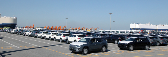 SsangYong Motor's Korando e-Motions wait to be loaded onto a ship headed overseas at a port in Pyeongtaek, Gyeonggi, on Thursday. The Korean automaker held a ceremony celebrating the first export of its first fully electric version of its popular SUV model. [SSANGYONG MOTOR]