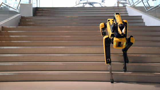 Four-legged Spot climbs up the stairs during a demonstration on Sept. 10. [HYUNDAI MOTOR]