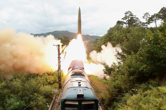 A ballistic missile is fired from a train-borne missile regiment in an undisclosed location in North Korea on Wednesday. [NEWS1]