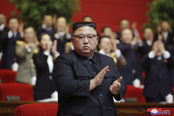 In this Jan. 10 file photo provided by the North Korean government, North Korean leader Kim Jong-un claps his hands at the ruling party congress in Pyongyang, North Korea. Korean language watermark on image as provided by source reads: ″KCNA″ which is the abbreviation for Korean Central News Agency. [KCNA/AP]