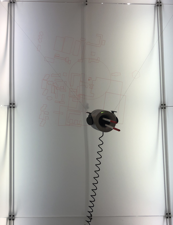 Scribit is shown here drawing a map at the biennale. [SHIN MIN-HEE]