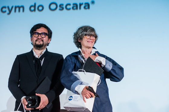 Directors Oan Kim, left, and Brigitte Bouillot received Silver Horn Award at the Krakow Film Festival in Poland in June. [KRAKOW FILM FESTIVAL]