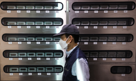 A man walks by electric meters at an apartment complex in Seoul on Sept. 23. The government announced electricity price rise for the first time in eight years. [YONHAP]