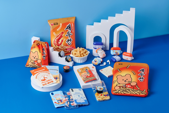 Nongshim merchandise in collaboration with Bind and Earp Earp. The products feature illustrations of Nongshim's famous shrimp-flavored chip Saewookkang and stationary brand Earp Earp's brown bear character. [NONGSHIM]