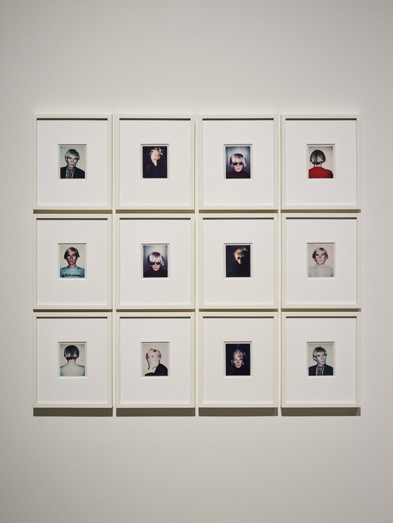 Polaroid photos taken by Warhol, showing him wearing his signature ″fright wig″ and posing in many ways [ESPACE LOUIS VUITTON SEOUL]