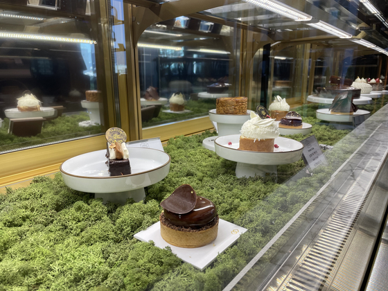 A showcase at Jardin d'Hiver offers a variety of French sweets. [LEE SUN-MIN]