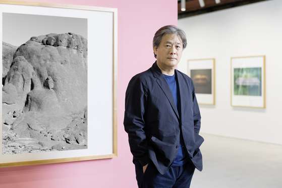 Filmmaker-turned-photographer Park Chan-wook poses for photos prior to the opening of his first solo exhibition ″Your Faces″ in Kukje Gallery, Busan. [KUKJE GALLERY]