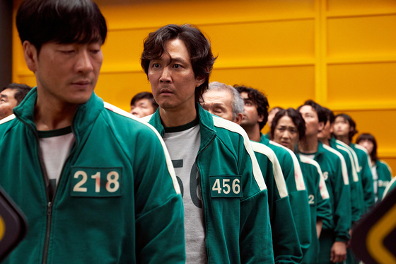 """Contestants wearing green tracksuits in """"Squid Game."""" [NETFLIX]"""