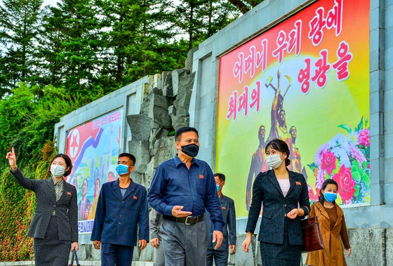 North Korean streets are plastered with colorful posters marking the 76th founding anniversary of its ruling Workers' Party, as reported in its state-run Rodong Sinmun Sunday. [YONHAP]