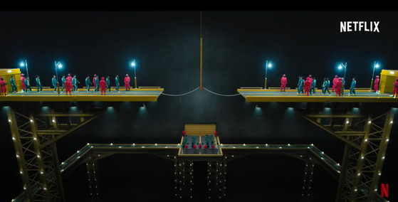In the tug of war match, the game takes place on top of a disconnected road. Chae explains there was a fixed theme from the start — people who are abandoned and forced to live on the streets. [NETFLIX]