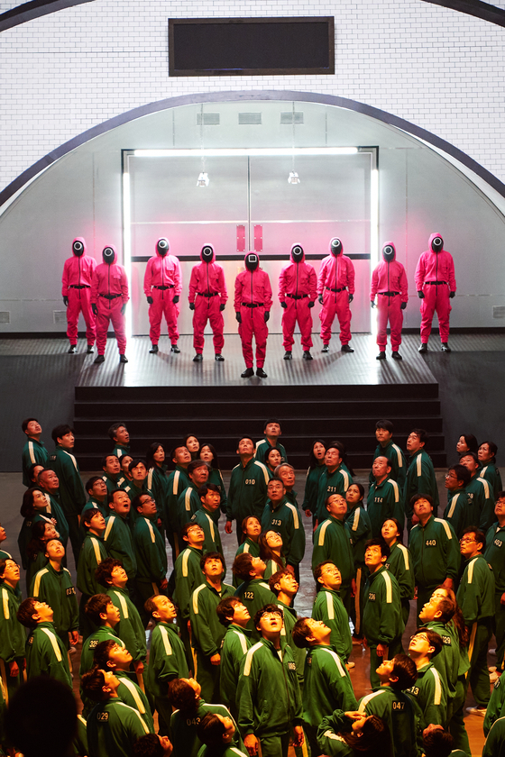 There is meaning to the main colors of the show: green and pink. Green is terrified of pink because it monitors and suppresses green. [NETFLIX]
