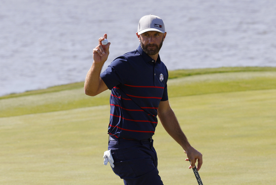 Dustin Johnson reacts after holing his birdie putt on the 5th green to win the hole during the Four-balls at the 2020 Ryder Cup held at Whistling Straits, Sheboygan, Wisconsin on Sept. 24. [REUTERS/YONHAP]