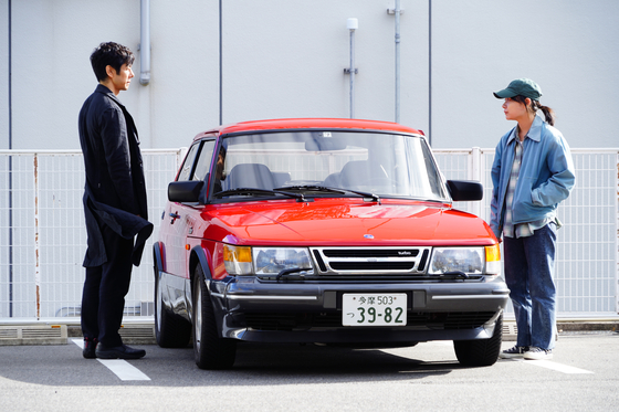 """A scene from """"Drive My Car,"""" which centers around theater director Kafuku (played by actor Hidetoshi Nishijima), left, and his driver Watari (played by actor Toko Miura). [BIFF]"""
