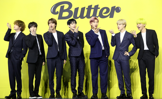 """""""Butter"""" (2021) was BTS's second English-lyric song. [BIG HIT MUSIC]"""