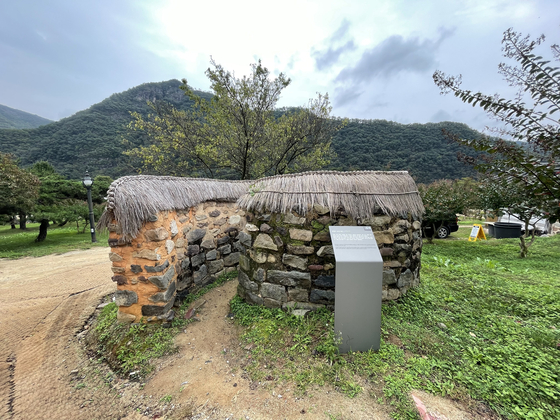 The outdoor toilet earned its nickname of a snail restroom thanks to its curves like the shell of a snail. [LEE SUN-MIN]
