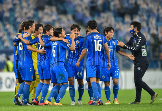 Ulsan Hyundai players celebrate after beating Persepolis FC of Iran in the final of the 2020 AFC Champions League in Doha, Qatar on Dec. 19, 2020. [XINHUA/YONHAP]
