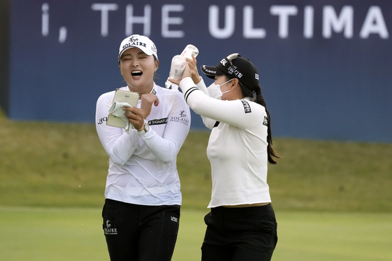 Ko Jin-young, left, reacts as she celebrates with other players after winning the BMW Ladies Championship at LPGA International Busan in Busan on Sunday/ [AP/YONHAP]